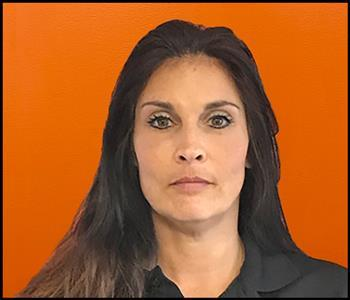 female employee with an orange background