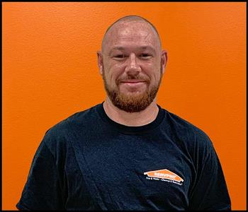 male employee with an orange background