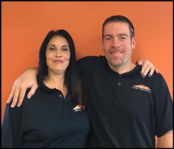 Image of female and male employee with an orange background