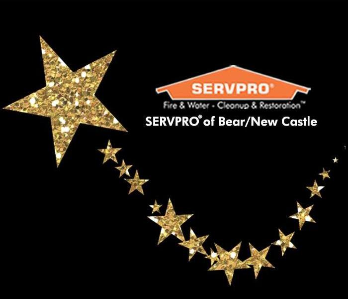 SERVPRO of Bear/New Castle's logo with gold glitter stars