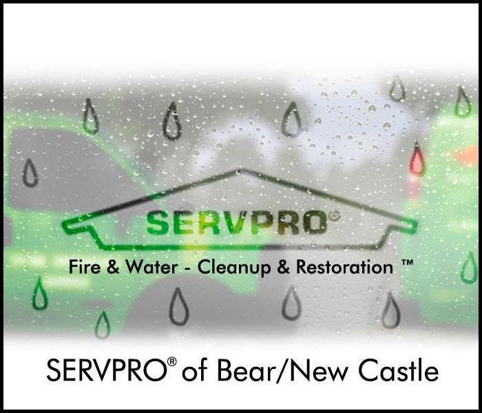 SERVPRO of Bear/New Castle's logo on wet, foggy window