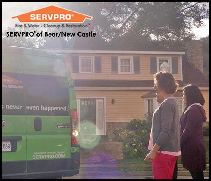 Women standing outfront of a home as a SERVPRO van pulls into driveway