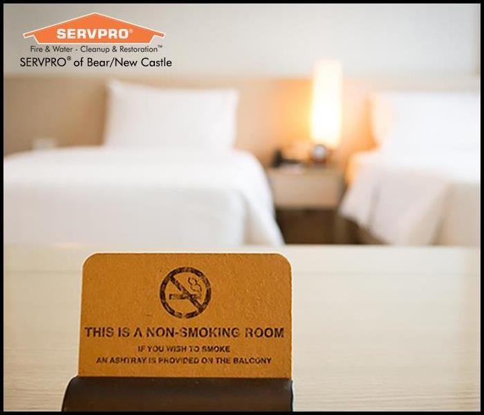 Non smoking sign on a hotel room bed